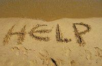 napis na plaży pomoc